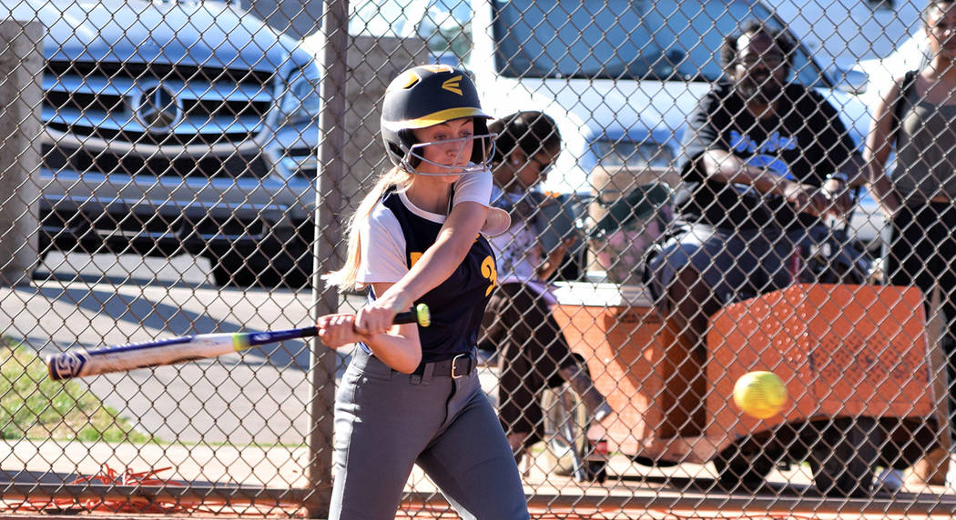 Robert Vendettoli/Boulder City Review Boulder City High School sophomore outfielder Ellie Ramsey drives a curve ball through the right field gap, using her speed to round the bases for an inside-t ...