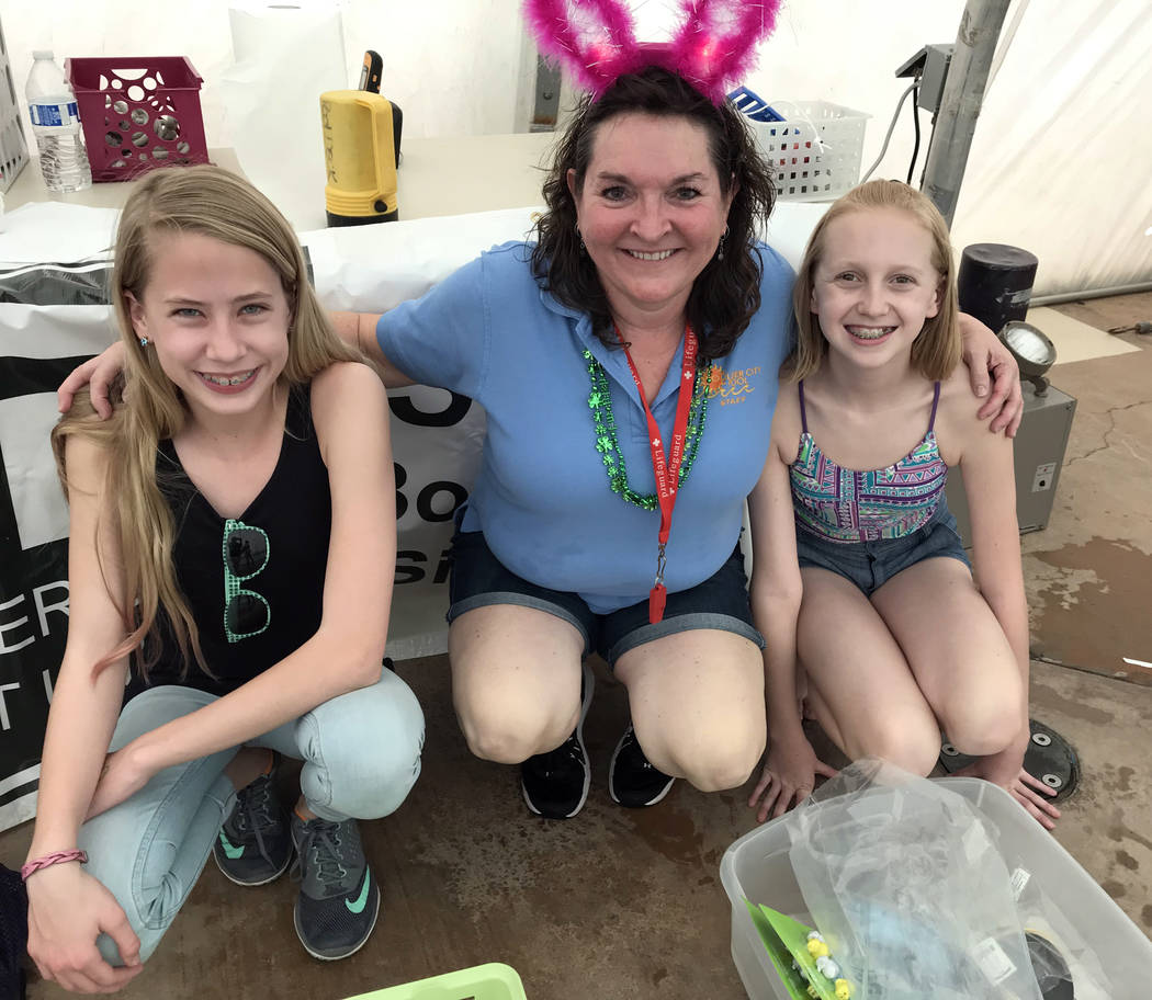 Hali Bernstein Saylor/Boulder City Review Cheree Brennan, center, aquatic coordinator, was assisted by Josie McClaren, left, and Avery Huysentruyt at Saturday's, March 17, 2018,  Easter Pool Plung ...