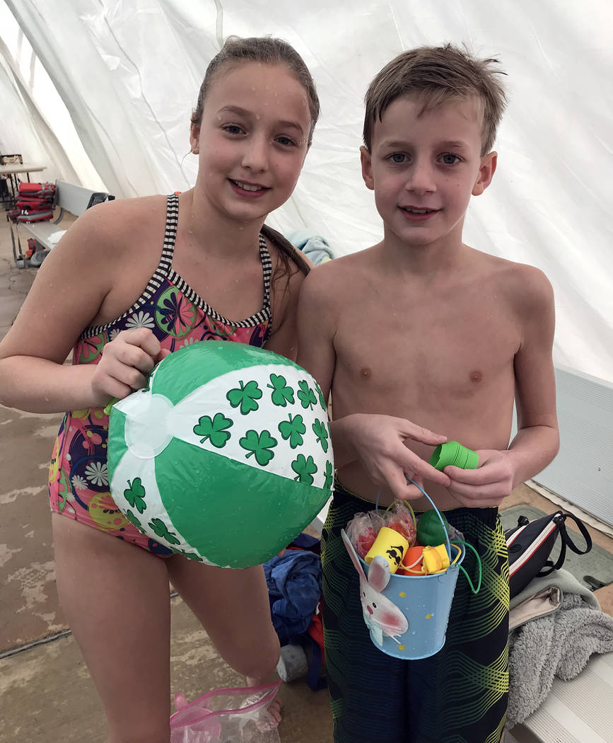 Hali Bernstein Saylor/Boulder City Review Siblings Kate and Jack Gelb, who were visiting from New York, collected a variety of toys during the third annual Easter Pool Plunge on Saturday, March 17 ...