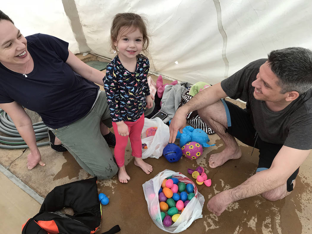 Hali Bernstein Saylor/Boulder City Review The Sergent family, from left, Sophia, Genevieve and Shane, came to the municipal pool Saturday, March 17, 2018, for the third annual Easter Pool Plunge.
