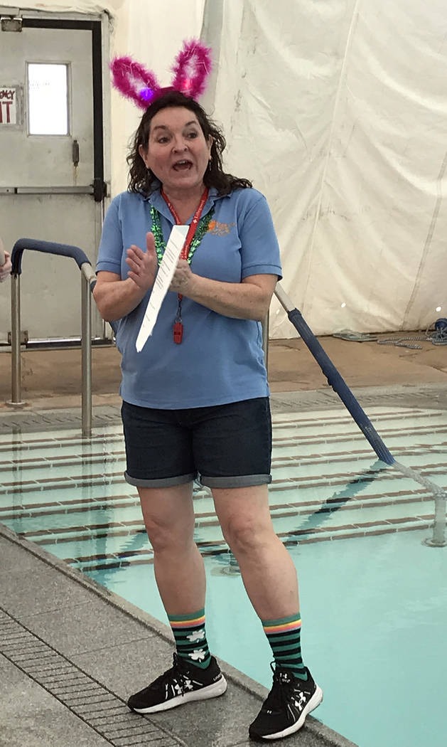 Hali Bernstein Saylor/Boulder City Review Cheree Brennan, aquatic coordinator, explains how the Easter Pool Plunge will work before the start of the event on Saturday, March 17, 2018.
