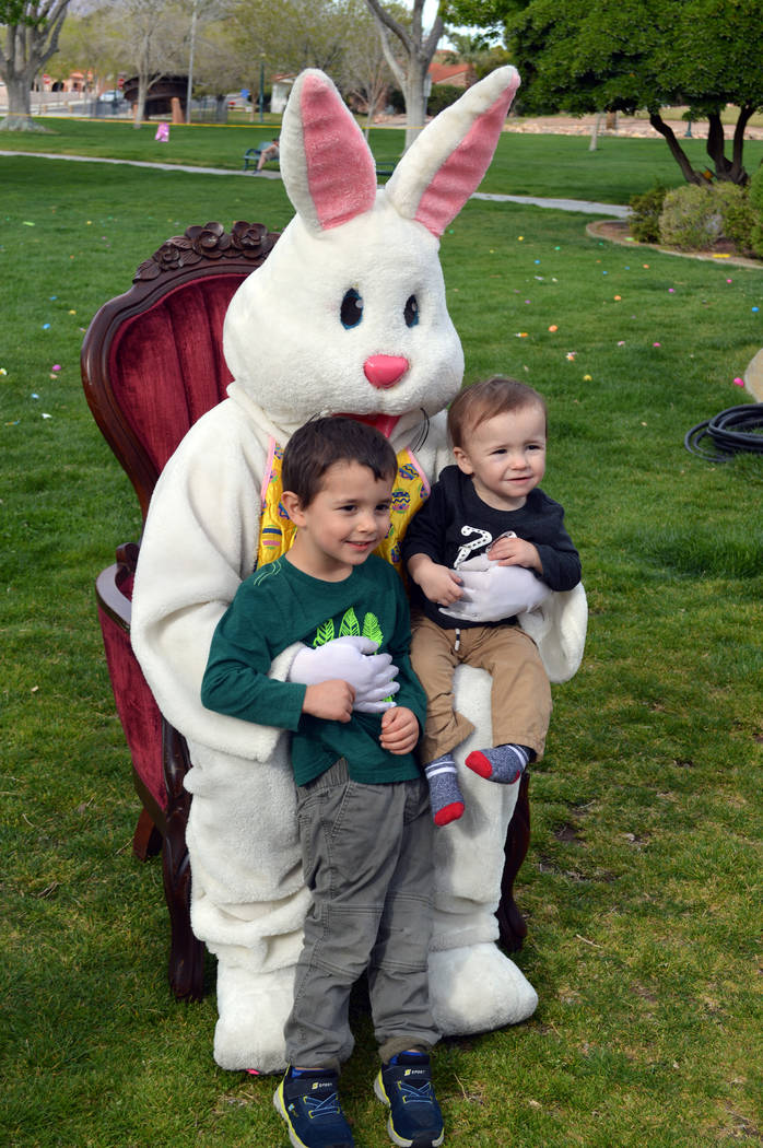 Celia Shortt Goodyear/Boulder City Review Jace Newbern, left, helps his younger brother, Everett, meet the Easter Bunny for the first time at the annual Easter egg hunt.