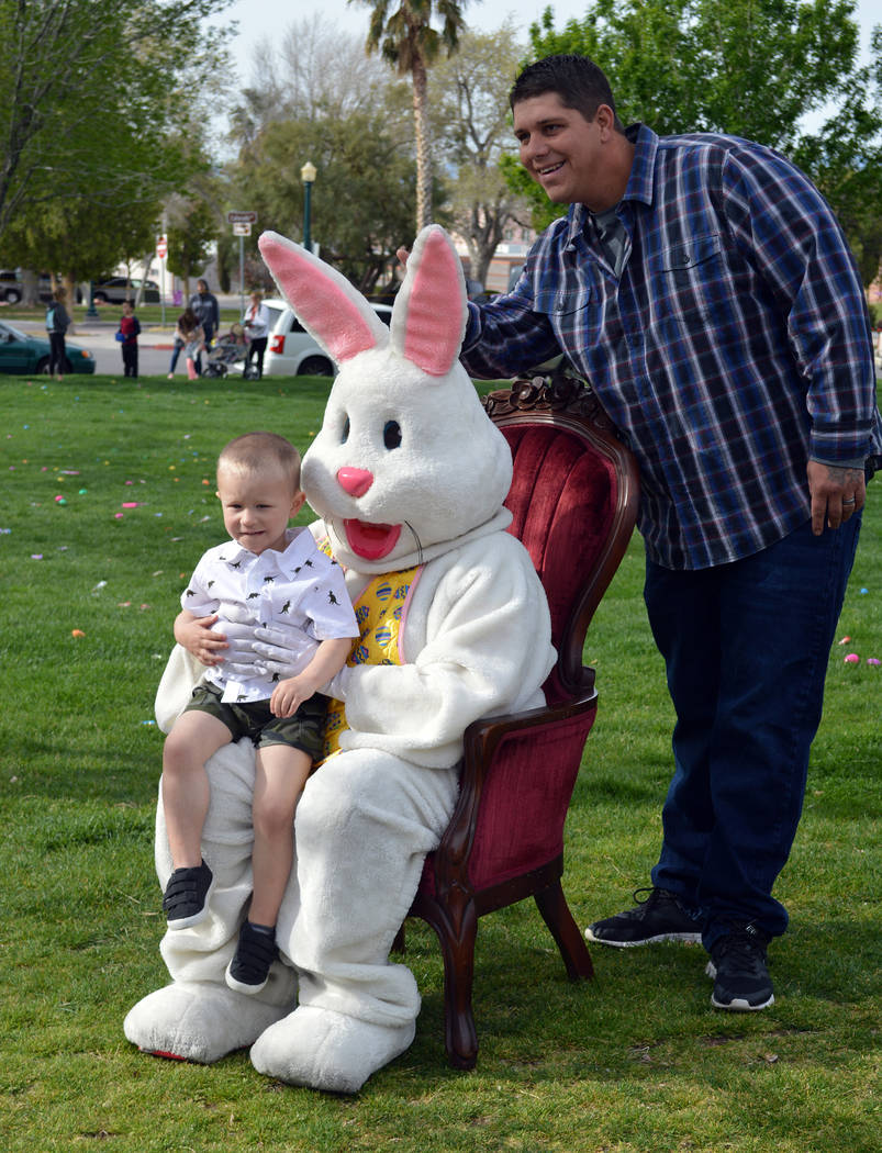 """Celia Shortt Goodyear/Boulder City Review Rick Bexley gives the Easter Bunny """"bunny ears"""" while his son, Landon, poses for a photo."""