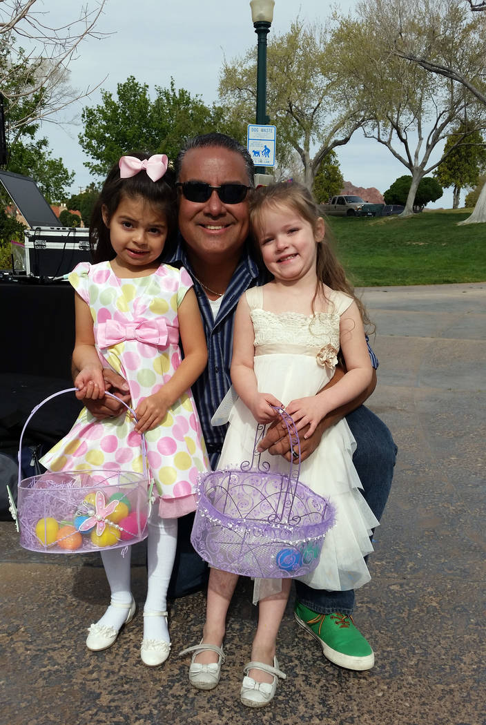Celia Shortt Goodyear/Boulder City Review In addition to DJing the Easter Egg Hunt on Saturday, Mike Pacini enjoyed some time with his great-nieces, Gwennie Villegas, left, and Hillary Williams.