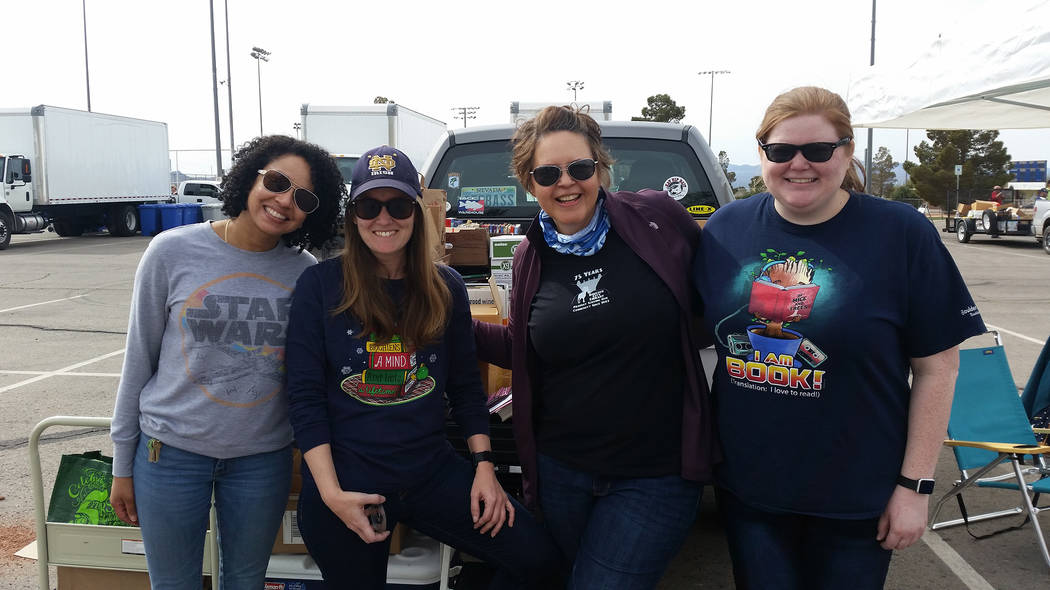 Celia Shortt Goodyear/Boulder City Review Boulder City Library employees, from left, Kesia Brooks, Jill Donahue, Kim Diehm, and Jessica Jones, enjoy the first Big Clean recycling event Saturday.