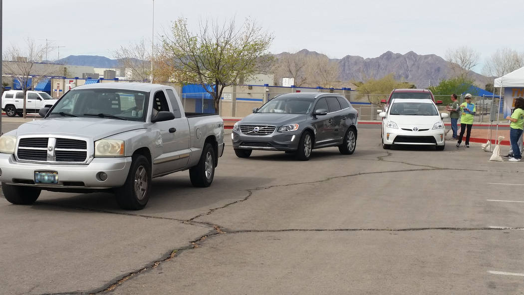 Celia Shortt Goodyear/Boulder City Review Vehicles line up at the city's Big Clean recycling event at Bravo Field on Saturday.