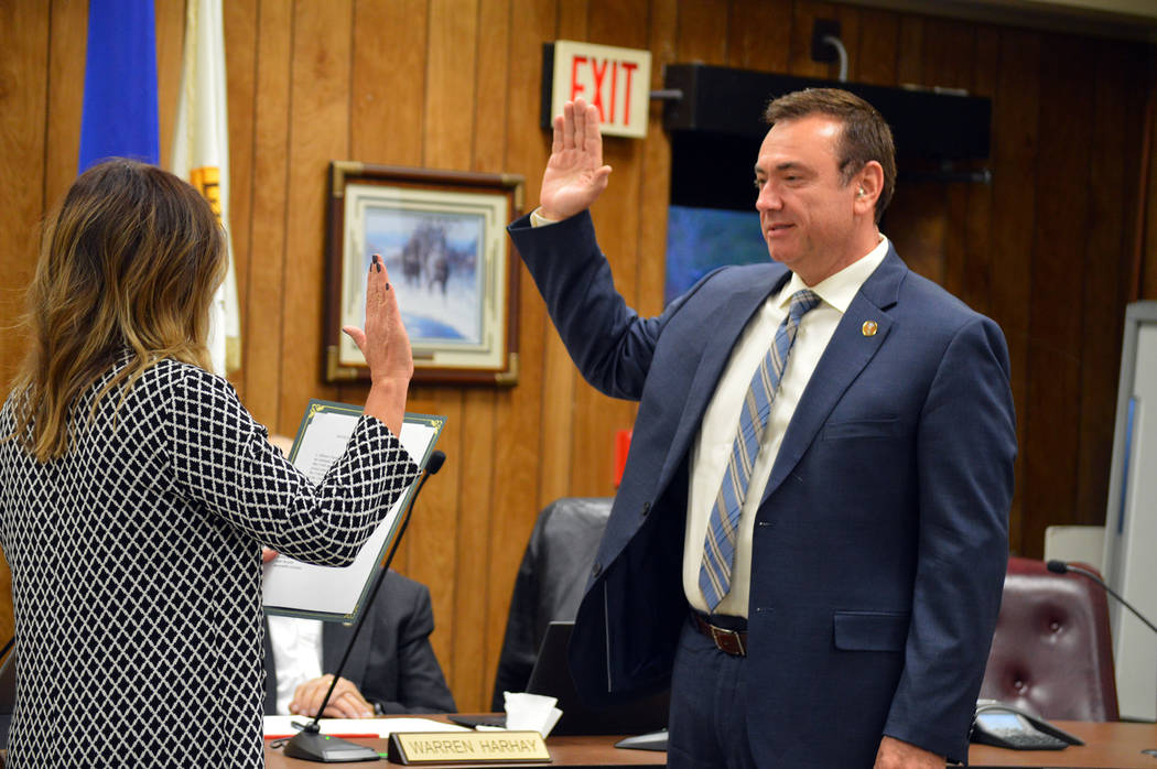 Celia Shortt Goodyear/Boulder City Review Deputy City Clerk Tami McKay swears in Boulder City's new City Manager, Al Noyola, at the City Council meeting Tuesday.
