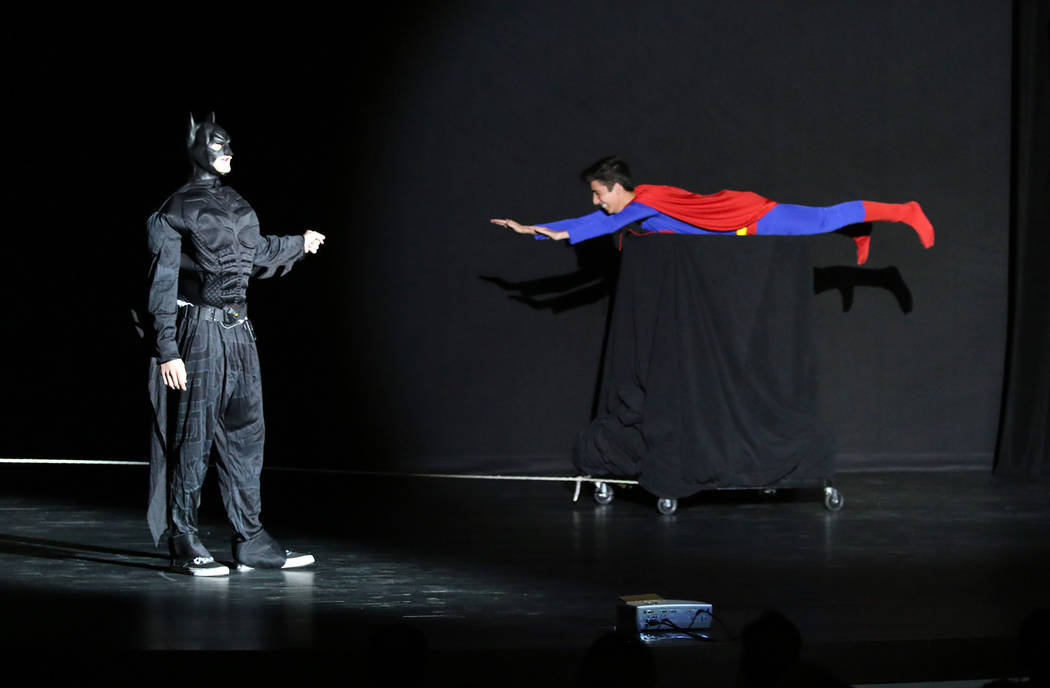Canaan Petersen Batman, played by A.J. Pouch, watches Superman, played by Asier Fernandez, fly by at the 2018 BCMAs on March 22 at the new Boulder City High School theater.