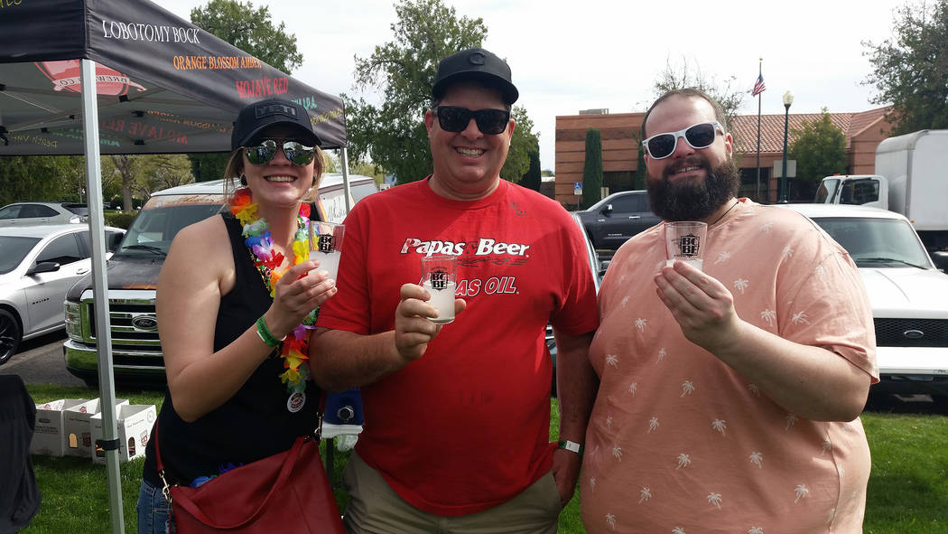Celia Shortt Goodyear/Boulder City Review Friends from Kingman, Arizona, from left, Jenna Harnisch, Jeff Hoehne and Joe Fellers, enjoy the 2018 Boulder City Beerfest on Saturday. Fellers is from B ...