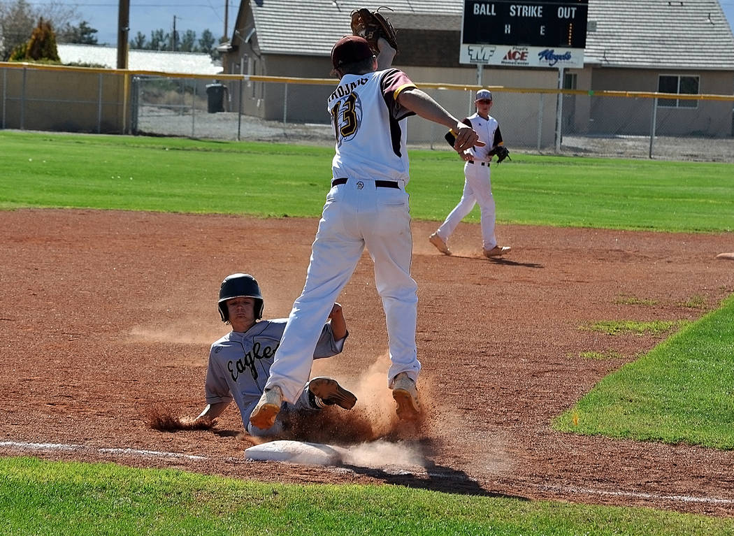 Horace Langford Jr./Pahrump Valley Times  Boulder City High School freshman Troy Connell slides into third during the Eagles' game against Pahrump Valley on Tuesday. He batted in two run in the ga ...