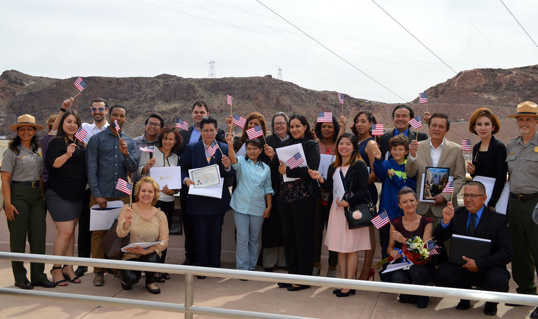 Celia Shortt Goodyear/Boulder City Review More than 20 of the United States' newest citizens celebrate with U.S. District Judge Peggy Leen and representatives of the National Park Service after be ...