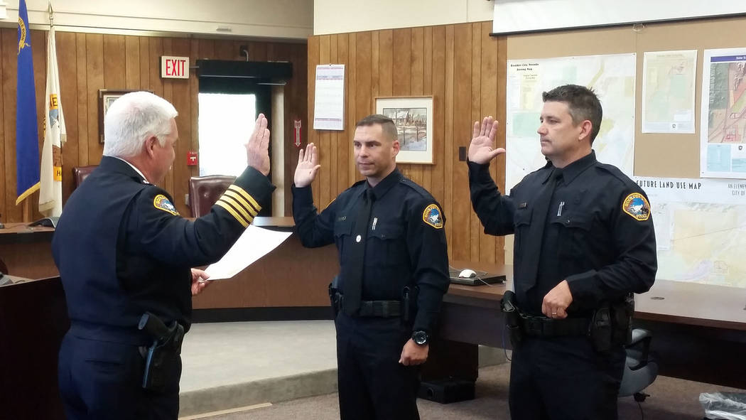 Celia Shortt Goodyear/Boulder City Review Boulder City Police Chief Tim Shea, left, swears in Boulder City's two newest police officers, Mike Petty, center, and Bret Hood, on Monday during a cerem ...