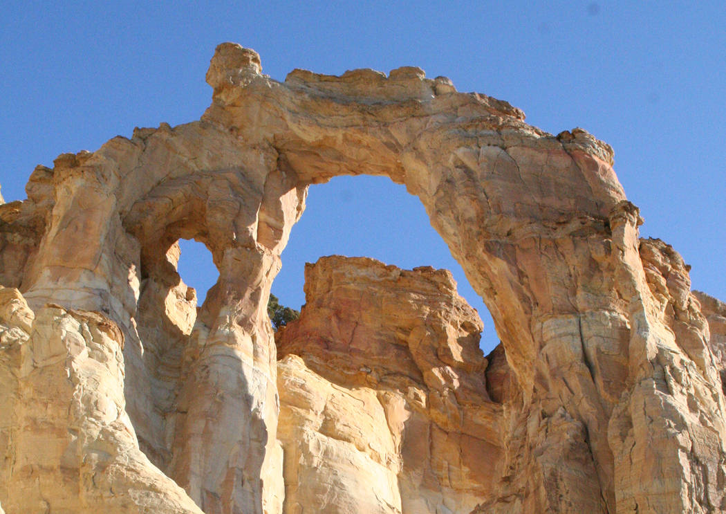 Deborah Wall Grosvenor Arch is a rare double arch about 11 miles south of Kodachrome Basin State Park in Utah.