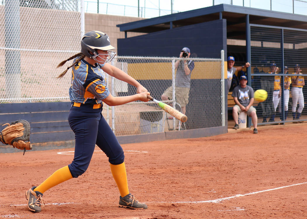 Laura Hubel/Boulder City Review At the plate, Boulder City High School junior Abby Giunta makes solid contact as the Moapa team looks on holding the lead during their game Friday. The Lady Eagles  ...