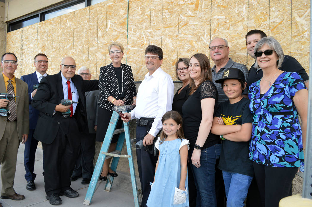 Celia Shortt Goodyear/Boulder City Review City officials and the Medo family get ready to say goodbye to the plywood on the windows of the old Vons/Haggen store on Boulder City Parkway, from left, ...