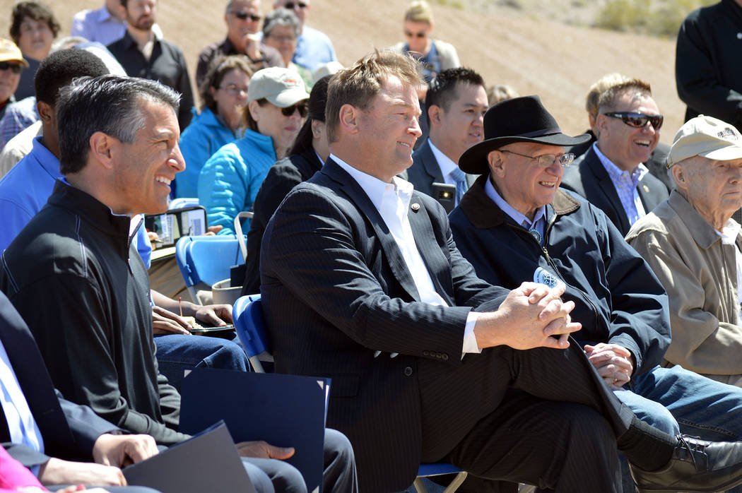 Celia Shortt Goodyear/Boulder City Review Nevada Gov. Brian Sandoval, left, U.S Sen. Dean Heller, middle, and Nevada Sen. Joe Hardy listen to a presentation during The Final Spike - A Historic Rec ...
