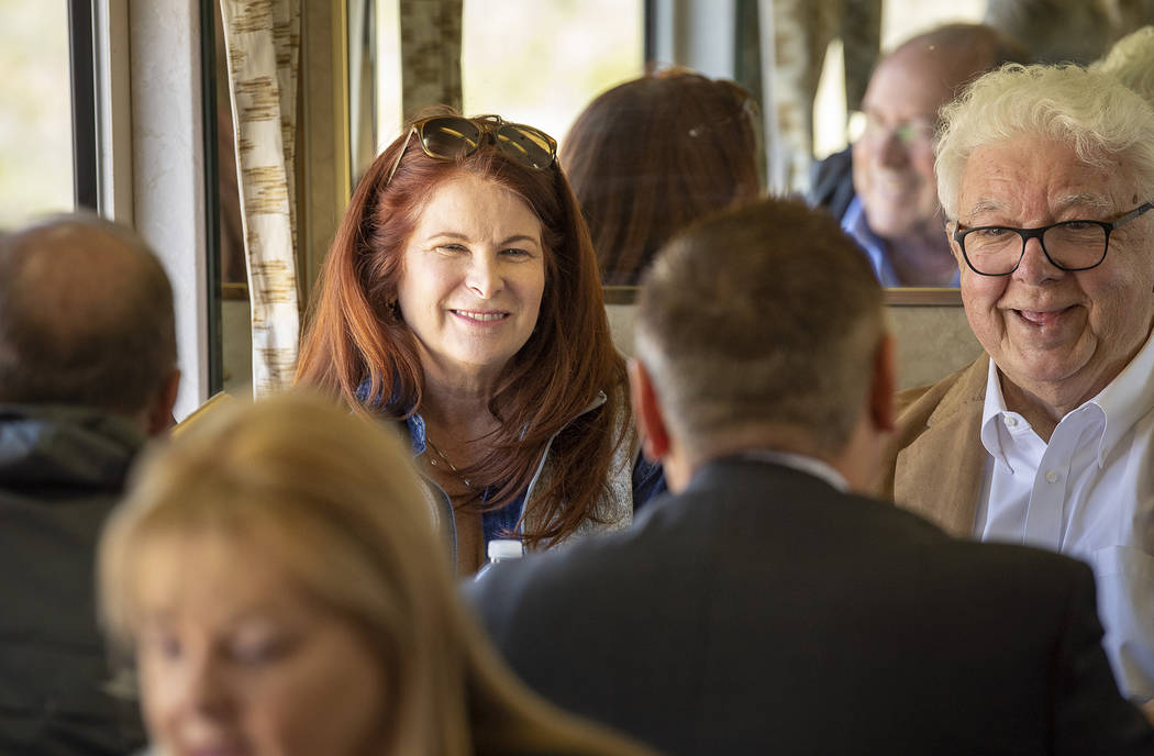 Mark Damon/Las Vegas News Bureau Henderson Mayor Debra March, left, and broadcaster and historian Bob Stoldal chat with friends on the train to the Final Spike Ceremony as the Nevada State Railroa ...