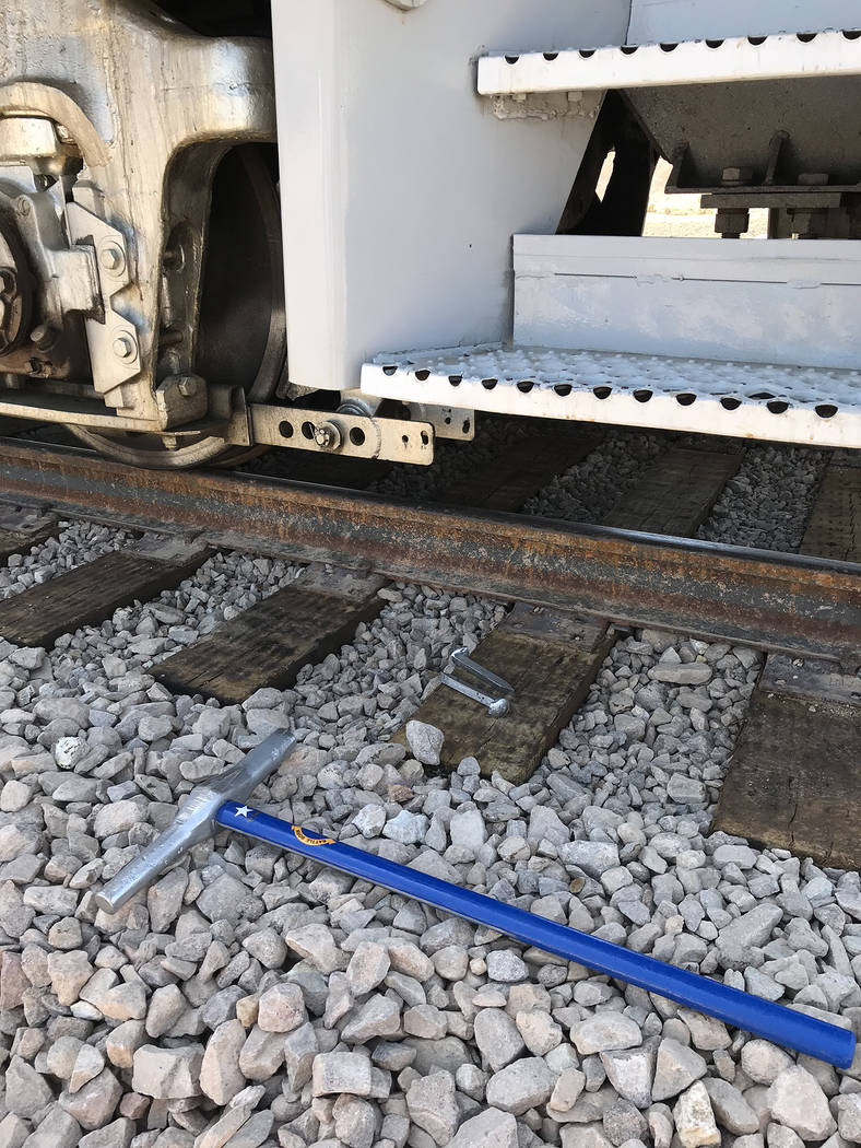 "Hali Bernstein Saylor/Boulder City Review A special Nevada themed maul and ""silver"" spkes were used to reconnect Boulder City and Henderson by railroad during the Final Spike ceremony on Friday. T ..."
