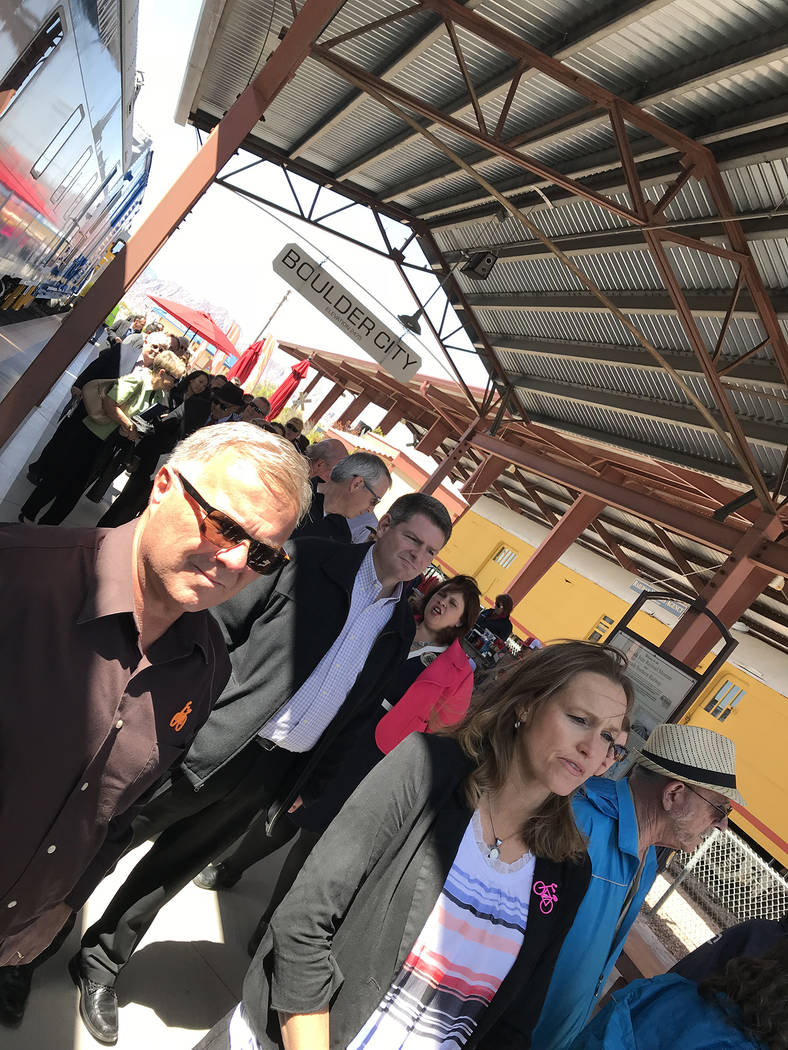 Hali Bernstein Saylor/Boulder City Review Guests for the Final Spike ceremony to mark the reconnection of Boulder City and Henderson by railroad get ready to board a train at the Nevada State Rail ...