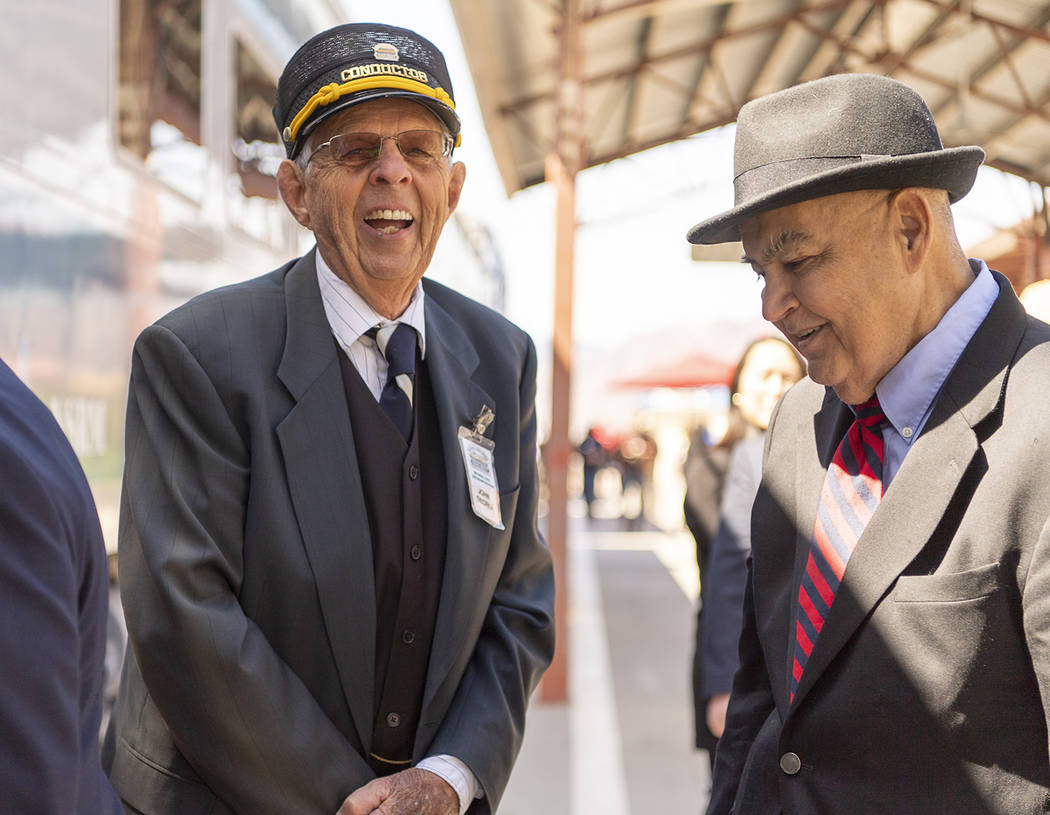 Mark Damon/Las Vegas News Bureau Conductor John Georgi, left, chats with passengers, including Councilman Warren Harhay, as they board the train for the Final Spike ceremony at the Nevada State Ra ...