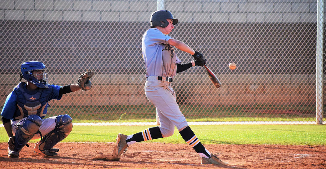 Boulder City High School senior outfielder Teddy Lobkowicz sprays a hit to center field Monday against Sierra Vista for a base hit. The Eagles lost 20-10. Robert Vendettoli/Boulder City Review
