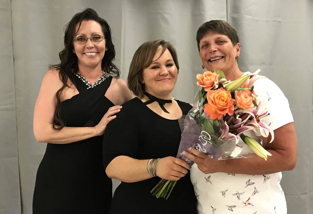 Hali Bernstein Saylor/Boulder City Review Kay Benge, right, was given special recognition by Gov. Brian Sandoval for her volunteer work at the Senior Center of Boulder City on Saturday, April 21, ...