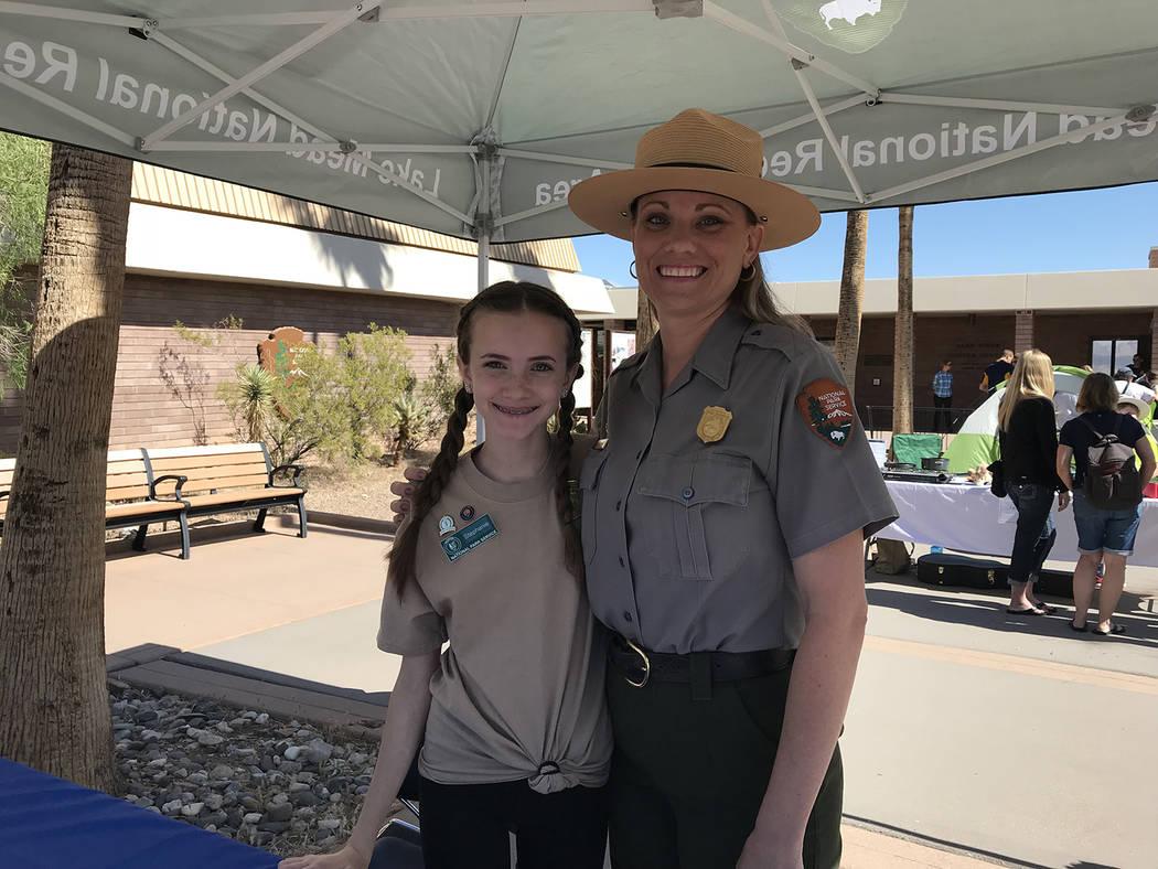 Hali Bernstein Saylor/Boulder City Review Stephanie McMartin, left, junior ranger ambassador for Lake Mead, helped her mother Sylvia McMartin check in prospective junior rangers during Saturday's ...
