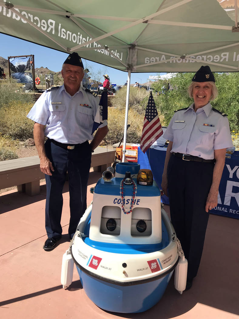 Hali Bernstein Saylor/Boulder City Review Bob Cromley and Wendy Park of the U.S. Coast Guard Auxiliary joined Coastie, the talking boat, to provide information about water safety during Junior Ran ...