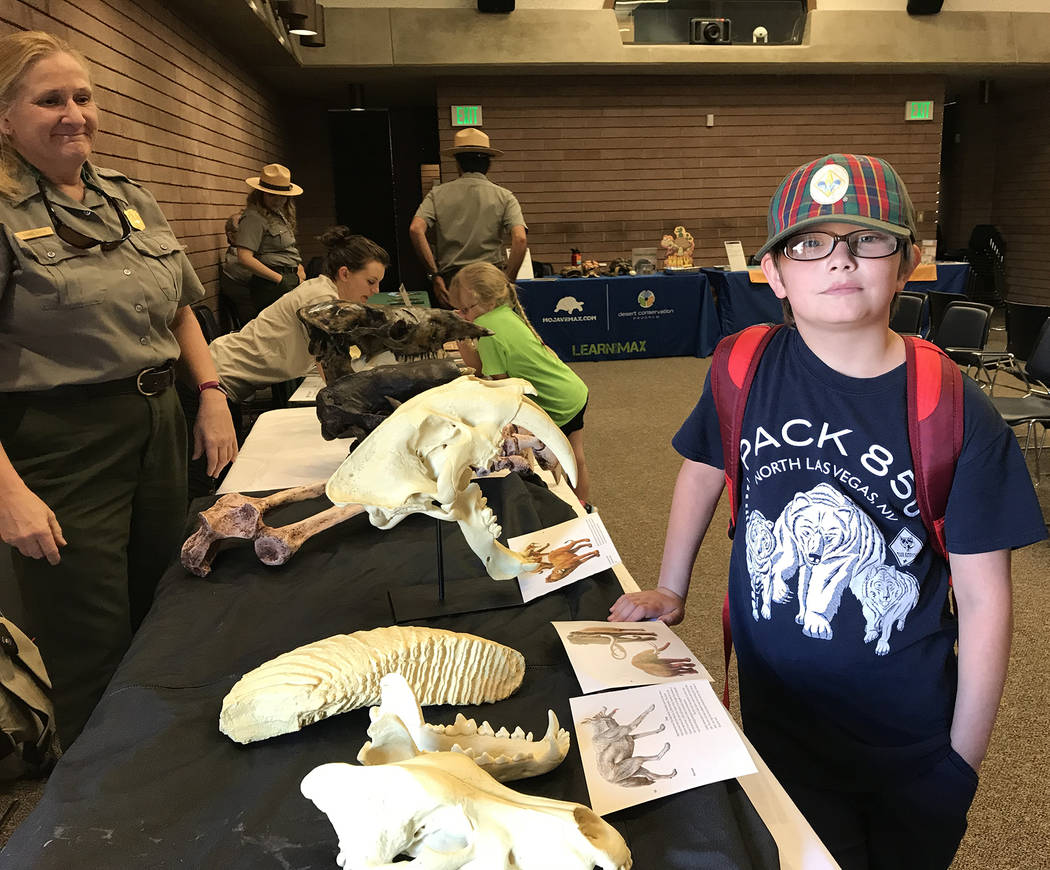 Hali Bernstein Saylor/Boulder City Review Aries Denning, 10, of Las Vegas, learned about fossils found at Tule Springs Fossil Beds National Monument Superintendent Diane Keith. Aries was on a ques ...
