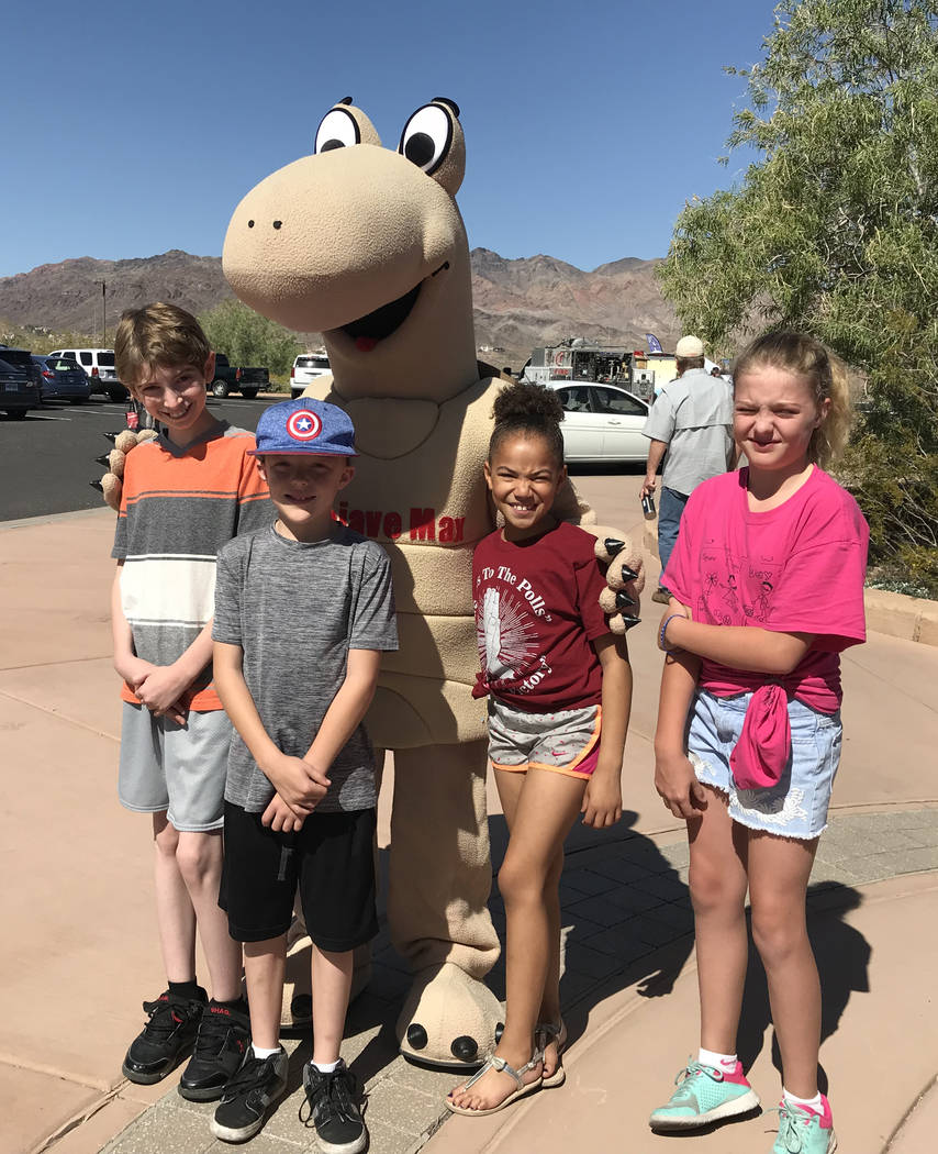 Hali Bernstein Saylor/Boulder City Review Posing for a picture with Mojave Max, the mascot for the Clark County Desert Conservation Program, were, from left, P.J. Alexander, Evan Shumway, Gwen Shu ...