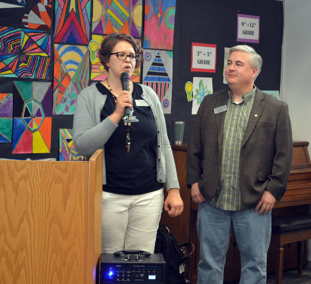 Celia Shortt Goodyear/Boulder City Review Library Director Kim Diehm and Board Chairman Jeff Breeden welcome the community to the library's 75 anniversary celebration on Friday.