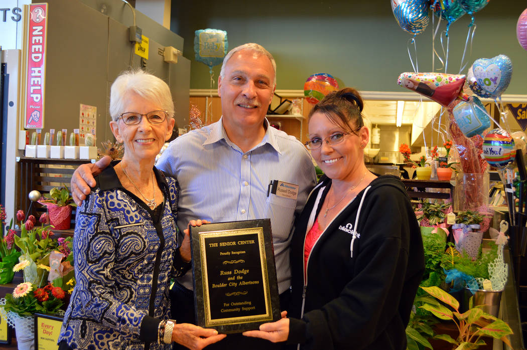 Celia Shortt Goodyear/Boulder City Review Susan Johnson, left, president of the Senior Center of Boulder City, and Executive Director Victoria Mason, right, presented a plaque of appreciation to R ...