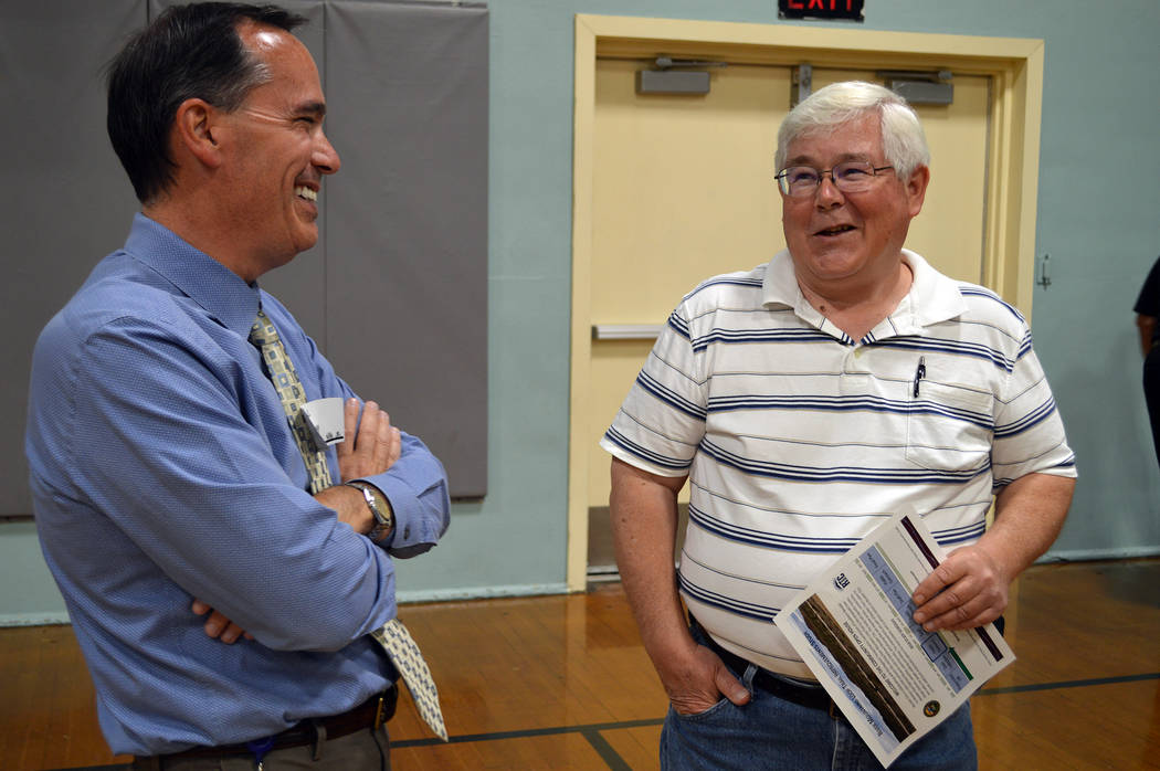 Celia Shortt Goodyear/Boulder City Review Boulder City Community Development Director Michael Mays, left, and City Councilman Kiernan McManus chat at the community open house April 26 to gain publ ...