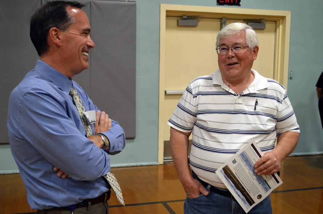 Celia Shortt Goodyear/Boulder City Review Boulder City Community Development Director Michael Mays, left, and City Councilman Kiernan McManus chat at the community open house April 26 to gain publ ...