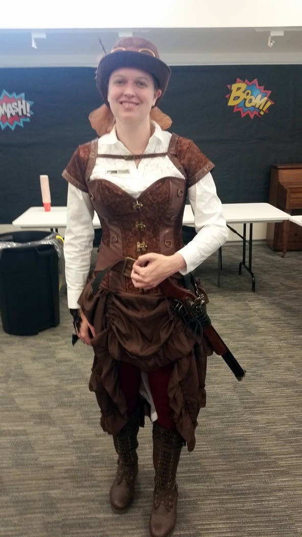 Celia Shortt Goodyear/Boulder City Review Samantha Bigger, head of information services at the Boulder City Library, dressed in historical attire for the cosplay portion of Superhero Saturday on S ...