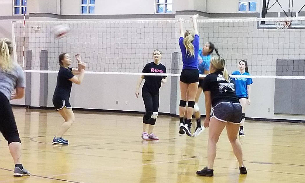 Kelly Lehr Members of the undefeated Synergy team play Henderson's Heavy Hitters in Boulder City Parks and Recreation Department's women's volleyball league. The double-elimination tournament begi ...