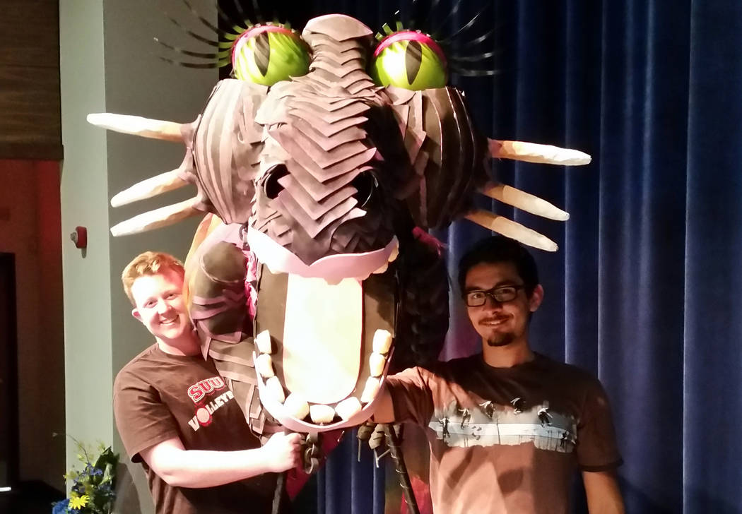 "Celia Shortt Goodyear/Boulder City Review Boulder City High School students, Hunter Moser, left, and Ricky Escamilla, showcase the dragon for the school's upcoming production, ""Shrek the Musi ..."