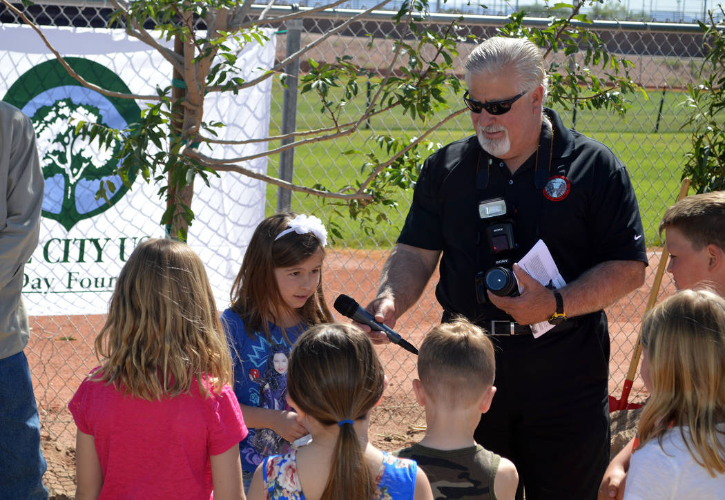 Celia Shortt Goodyear/Boulder City Review Boulder City second-grader Lilly Potter reads an original poem about Arbor Day with Parks and Recreation Director Roger Hall on April 26. The city also pl ...