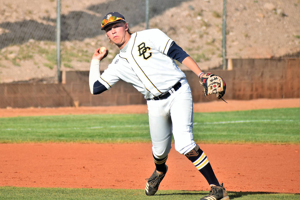 Robert Vendettoli/Boulder City Review Boulder City High School senior third baseman Rhett Armstrong scoops up a ground ball and throws the runner out at first in the Eagles' 14-2 victory against S ...