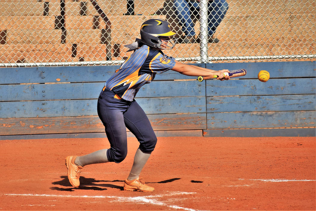 Robert Vendettoli/Boulder City Review Jordan Moorhead , a senior at Boulder City High School, slaps a bunt against Southeast Career Technical Academy on April 25 in the Lady Eagles' 22-5 victory.