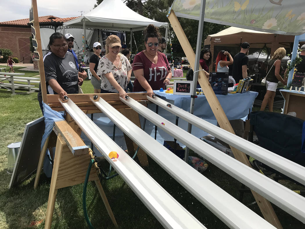 Hali Bernstein Saylor/Boulder City Review Downtown Dental sponsored a water-powered duck race at this year's Spring Jamboree, held May 5 and 6, 2018. Here, staff members, from left, Felicia Cisco, ...