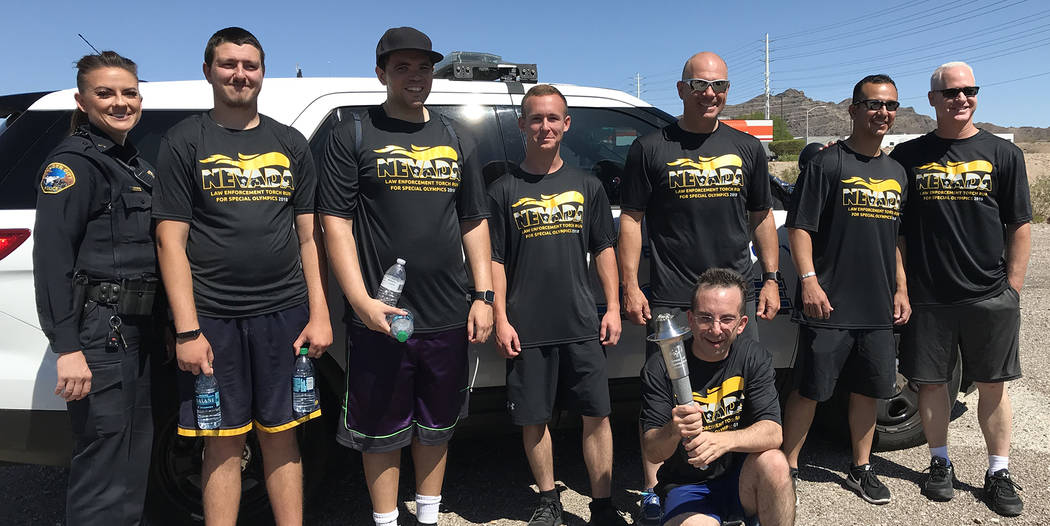 Hali Bernstein Saylor/Boulder City Review Posing for a quick picture before heading down U.S. Highway 93 with the Flame of Hope for Special Olympics on Friday were, from left, Officer Jen Woolsey, ...