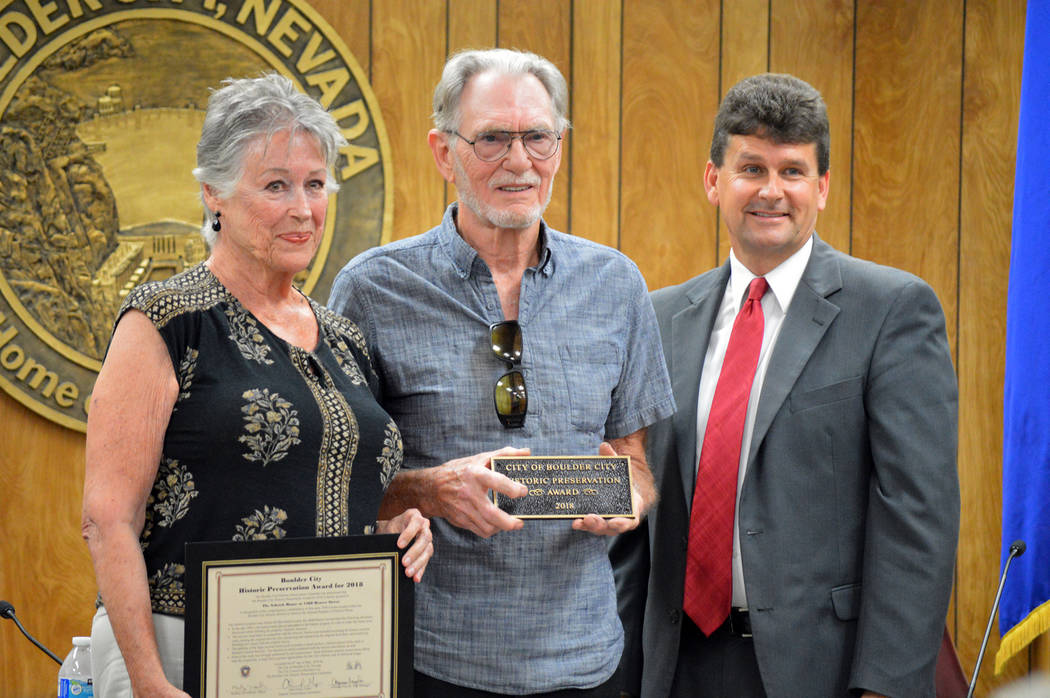 Celia Shortt Goodyear/Boulder City Review Boulder City Mayor Rod Woodbury, right, presents Linda and Marvin Schrick with the 2018 Historic Preservation Award at Tuesday's City Council meeting for ...