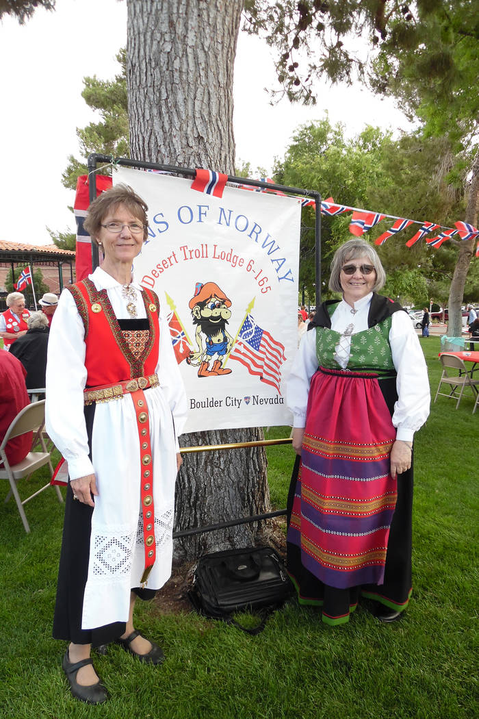Hali Bernstein Saylor/Boulder City Review Lettie Zimmerman, left, and Barb Stuebner, members of the Desert Troll Lodge, Sons of Norway, wore traditional Norwegian attire to the Norwegian Constitut ...