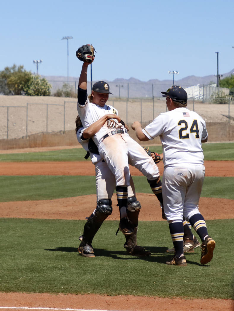 Boulder City High School Yearbook Shaun Jones picks up Rhett Armstrong while Nolan Herr celebrating.