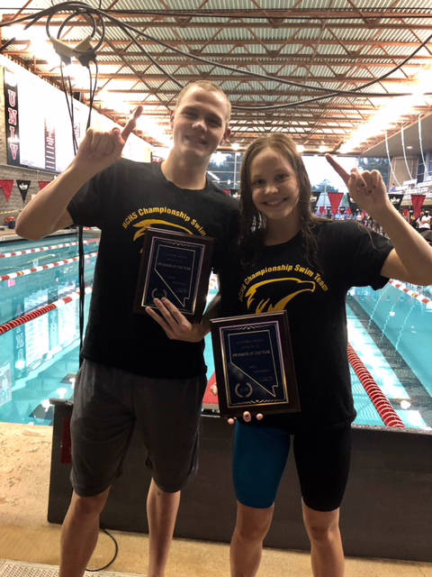 Sara Carroll Boulder City High School swim team members and twins, A.J. and Rose Pouch are named the regional swimmers of the year.