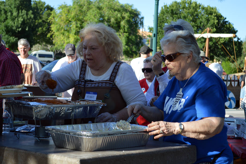Celia Shortt Goodyear/Boulder City Review Minna Anderson, left, and Agnes Jevne serve Norwegian food to guests at the Sons of Norway Constitution Day celebration May 17 at Bicentennial Park.