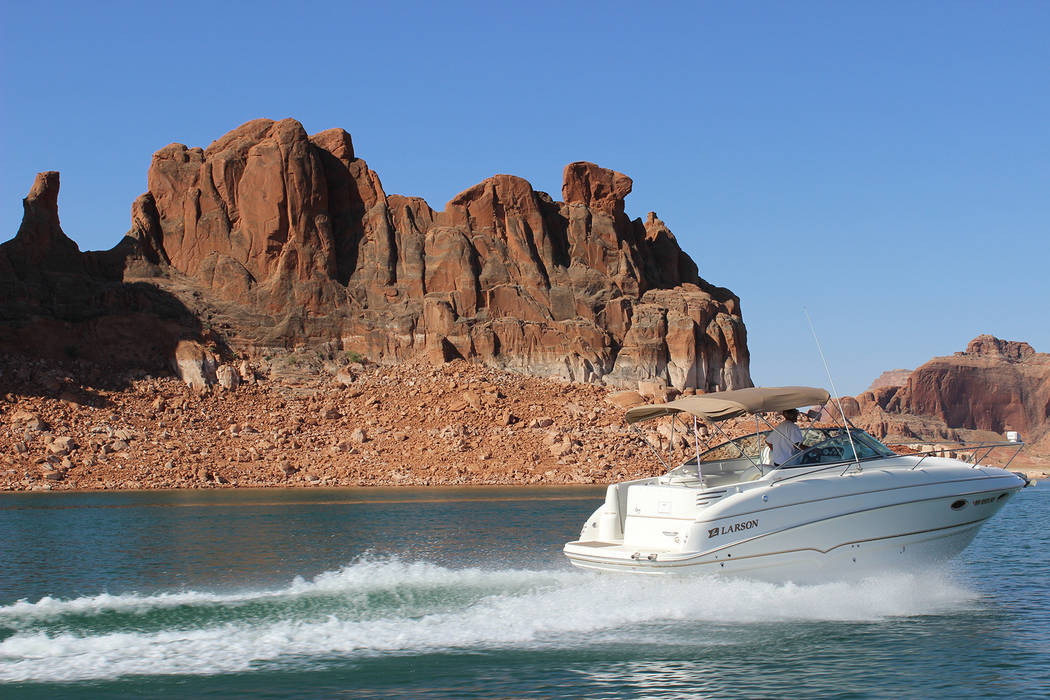 Deborah Wall Lake Powell has 1,800 miles of stunning shoreline, much of it suitable for an easy rest stop, swim, fishing spot or camping the night. The lake is within the Glen Canyon National Recr ...