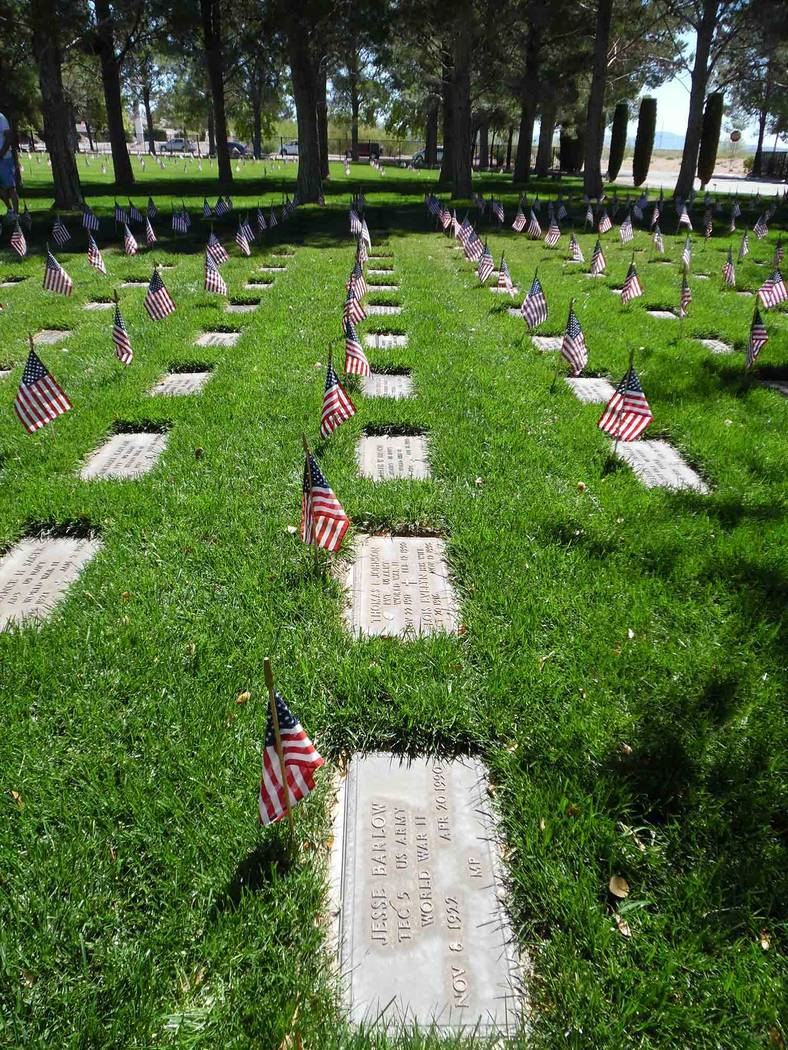 File Flags fly above the graves of veterans buried at the Southern Nevada Veterans Memorial Cemetery in Boulder City in 2017. They will be placed starting at 7 a.m. Saturday, May 25, for Memorial ...