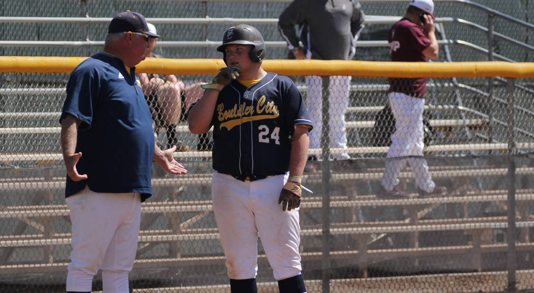 Boulder City High School yearbook Boulder City High School senior Nolan Herr, left, confers with head coach Ed McCann during the Eagles' season-ending 9-5 loss against Pahrump Valley during their ...